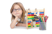 Girl with abacus on white — Stock Photo