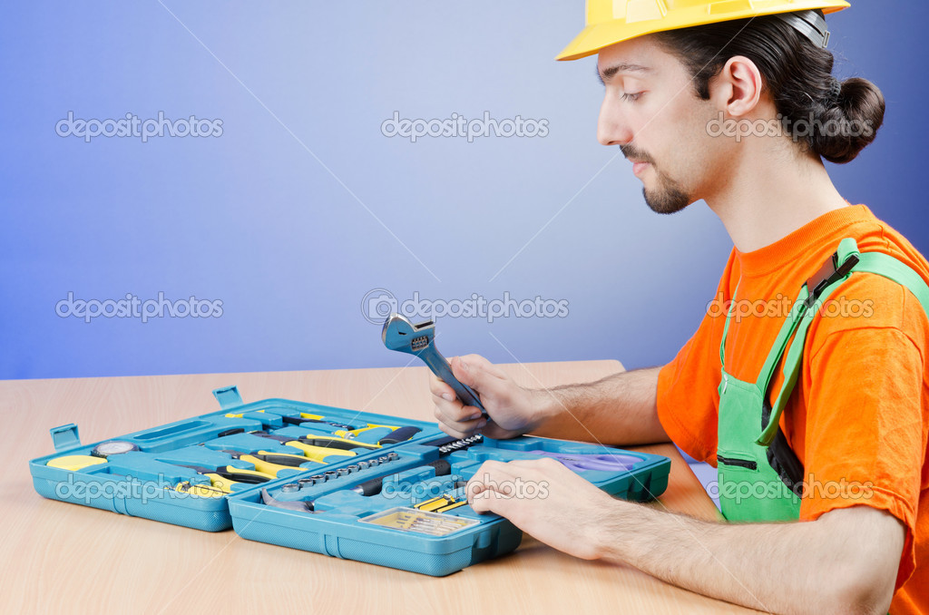 Repairman with his toolkit — Stock Photo #11636386