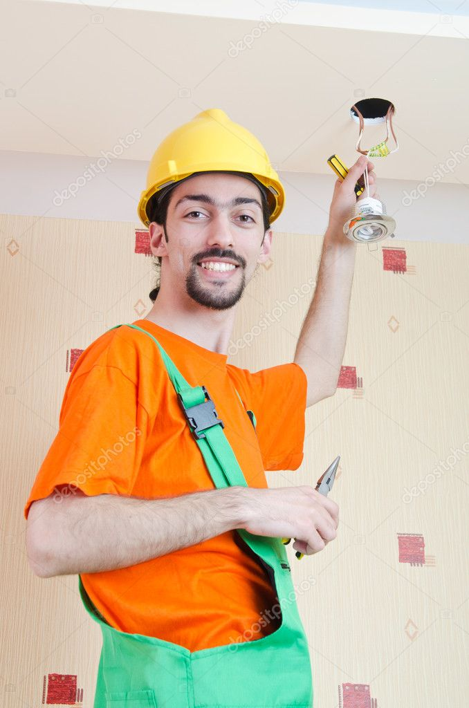 Electrician working on cabling lighting  Stock Photo #11636577