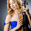 Woman with violin in studio - Stock Photo