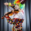 Clown playing on the violin - Zdjęcie stockowe