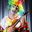 Clown playing on the violin - Stock Photo