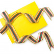 Envelope with colourful ribbon on white — Stock Photo