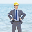 Oil engineer on sea side beach — Stock Photo