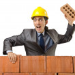 Businessman with bricks on white — Stock Photo
