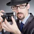 Photographer man with vintage camera - Foto Stock