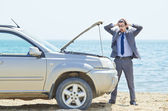 Man with car on seaside — Stock Photo