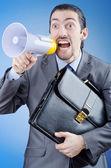 Businessman shouting via loudspeaker — Stock Photo