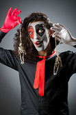 Joker with face mask in studio — Stock Photo