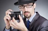Photographer man with vintage camera — Stock Photo