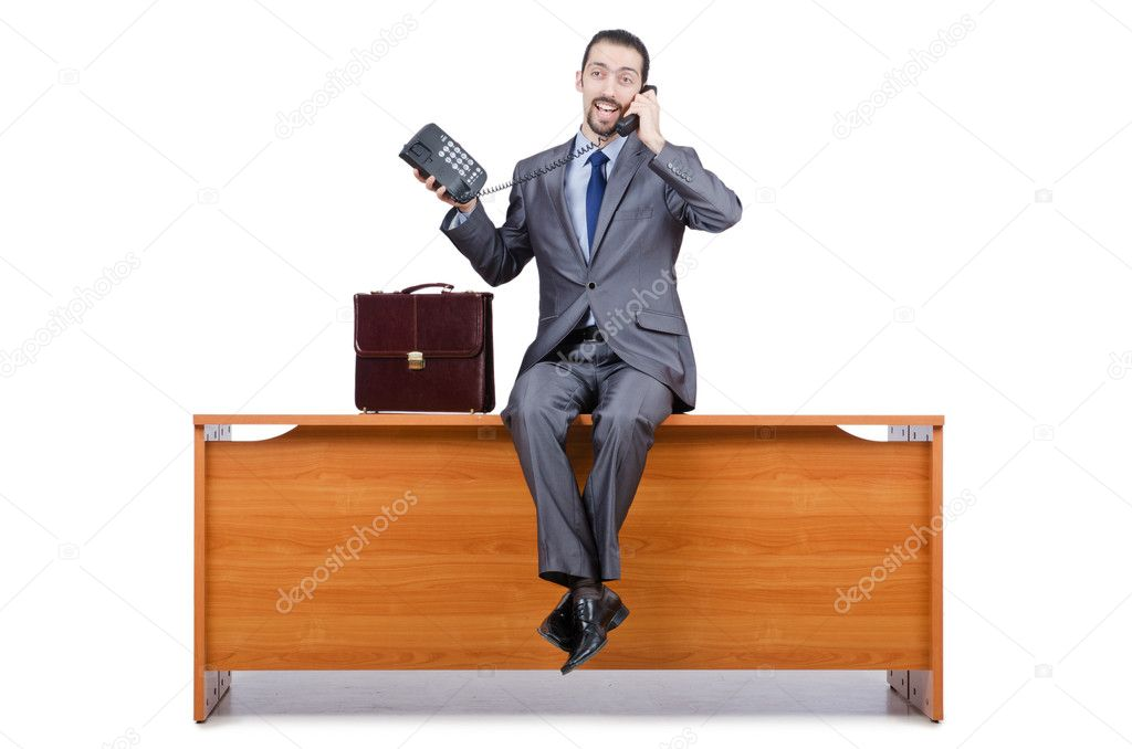 Businessman sitting on desk and speaking phone — Stock Photo #11903537