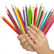 Hand holding colour pencils on white — Stock Photo