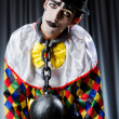 Stock Photo: Clown with shackles in studio