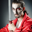 Japanese actor with sword — Stockfoto #12023287