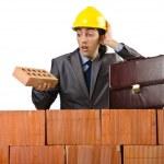 Businessman near brick wall — Stock Photo #12024103