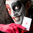 Stock Photo: Joker with cards in studio shoot