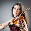 Female violin player against background — Stock Photo #12024759