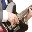 Guitar player in business suit on white — Stock Photo #12025319