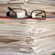 Stock Photo: Pile of papers on white