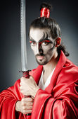 Japanese actor with sword — Stock Photo