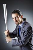 Boos zakenman met bat op wit — Stockfoto