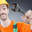 Man with a wrench in a studio — Stock Photo #12153676
