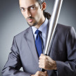Angry businessman with bat on white — Stock Photo #12153896