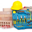 Construction concept with helmet and toolkit - Stock Photo