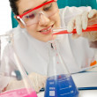Stock Photo: Female chemist in studio on white