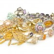 Lots of jewellery on white — Stock Photo