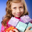 Little girl with giftboxes — Stock Photo