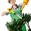 Womgardener trimming plans on white — Stock Photo #12156323