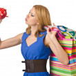 Girl spending all savings on shopping - Stockfoto
