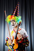 Clown playing on the violin — Stock Photo