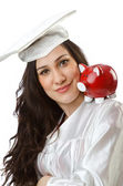 Expensive education concept with student and piggy bank — Stock Photo
