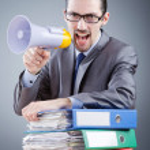 Businessman shouting via loudspeaker — Stock Photo #12323482
