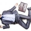 Dead businessman on the floor — Stock Photo