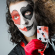 Joker with face mask in studio — Stock Photo #12324695
