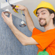 Stock Photo: Electricirepairmworking on refurbishment