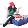 Girl packing for travel vacation — Stock Photo
