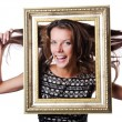 Young woman with picture frame on white — Stock Photo