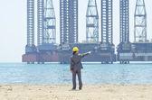 Oil engineer on sea side beach — Stock Photo