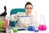 Female chemist in studio on white — Stock Photo