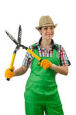 Girl with garden scissors on white — Stockfoto