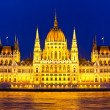 Budapest Parliament at night with reflection in Danube river - Stock Photo