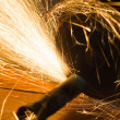 Worker cuts a metal pipe — Stock Photo