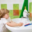 Little girl washes hands. — Stock Photo