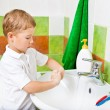 Royalty-Free Stock Photo: Boy washes with hand soap.