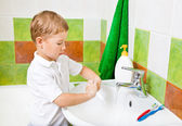 Boy washes with hand soap. — Stock Photo