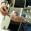 Stock Photo: Musiciplays acoustic guitar.